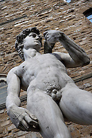 Low angle view of replica of statue of David, by Michelangelo, in front of the Palazzo Vecchio, Piazza della Signoria, Florence, Tuscany, Italy, pictured on June 10, 2007, in the afternoon. The original sculpture of David, 1504, by Michelangelo di Lodovico Buonarroti Simoni (1475-1564), stood here until 1873, when it was moved to the Accademia Gallery. This replica was erected in 1910. Florence, capital of Tuscany, is world famous for its Renaissance art and architecture. Its historical centre was declared a UNESCO World Heritage Site in 1982. Picture by Manuel Cohen