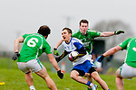 Welcome to division one: Mike Burke Milltown/Castlemaine tackles Maurice Hickey Castleisland Desmonds during their division one league game in Milltown on Saturday