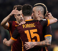 Calcio, Serie A: Roma vs Frosinone. Roma, stadio Olimpico, 30 gennaio 2016.<br /> Roma&rsquo;s Miralem Pjanic, center, celebrates with teammates Stephan El Shaarawy, left, and Radja Nainggolan, after scoring during the Italian Serie A football match between Roma and Frosinone at Rome's Olympic stadium, 30 January 2016.<br /> UPDATE IMAGES PRESS/Isabella Bonotto