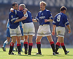 Paul Gascoigne is congratulated by Ian Ferguson and Alexei Mikhailichenko after scoring his first goal for Rangers at Ibrox in the League Cup against Morton. 19th August 1995