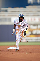 Tampa Yankees center fielder Jorge Mateo (14) running the bases during a game against the Fort Myers Miracle on April 12, 2017 at George M. Steinbrenner Field in Tampa, Florida.  Tampa defeated Fort Myers 3-2.  (Mike Janes/Four Seam Images)