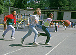Oakland CA Multiracial group of third grade girls playing on school play ground