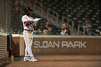 Scottsdale Scorpions second baseman Shed Long (6), of the Cincinnati Reds organization, on deck during an Arizona Fall League game against the Mesa Solar Sox at Sloan Park on October 10, 2018 in Mesa, Arizona. Scottsdale defeated Mesa 10-3. (Zachary Lucy/Four Seam Images)