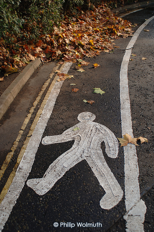 Pedestrian walkway at the entrance to Paddington Recreation Ground, which is managed by Westminster City Council.