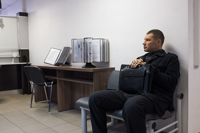 Anatolij waiting at the Moscow governmental services center, to register his newborn baby