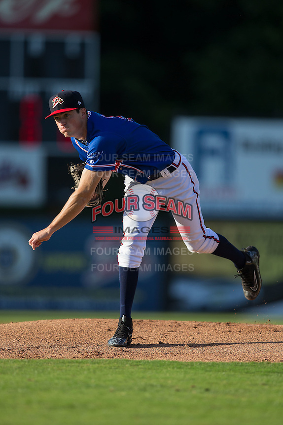 Danville Braves starting pitcher Jaret Hellinger (11) follows through on his delivery against the Kingsport Mets at American Legion Post 325 Field on July 9, 2016 in Danville, Virginia.  The Mets defeated the Braves 10-8.  (Brian Westerholt/Four Seam Images)