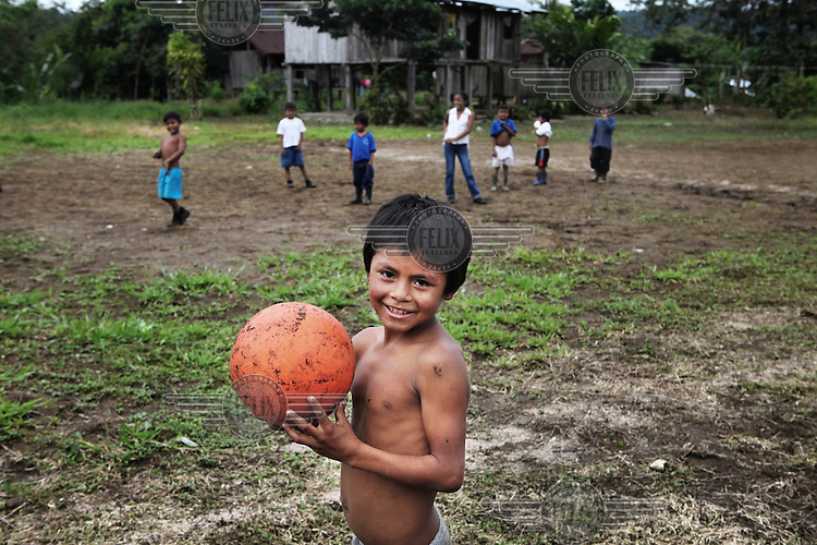 Children play football in a school in the Oriente. This is the Amazon rainforest region of eastern Ecuador, it is inhabited by a tiny fraction of the country's population. Most of the people living here are indigenous people and illiteracy is widespread.