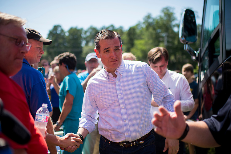 UNITED STATES - AUGUST 8: Presidential candidate Sen. Ted Cruz (R-TX) shakes hands with supporters as he emerges from the Cruz campaign bus for a rally in a field behind Sprayberry's BBQ in Newnan, Ga., on Saturday, Aug. 8, 2015. (Photo By Bill Clark/CQ Roll Call)