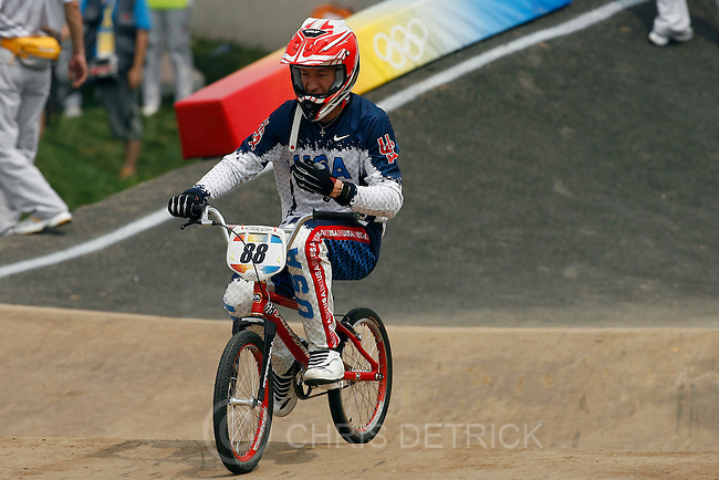 USA's Kyle Bennett rides on the BMX course after crashing during in the Men's Quarterfinals round at the BMX Venue in Beijing, Wednesday, August 20, 2008. ..Chris Detrick/The Salt Lake Tribune.