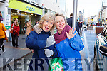 Joan Griffin and Mercy Lawlor from Tralee joining in the sing song at the annual Christmas Garda music and street collection in the Mall on Monday.