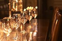 In a wine tasting room glasses lined up on a dark wooden table for a tasting with chairs. Ulriksdal Ulriksdals Wärdshus Värdshus Wardshus Vardshus Restaurant, Stockholm, Sweden, Sverige, Europe
