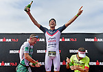 OCEANSIDE, CA - APRIL 7:  (L-R) 2nd place Lionel Sanders of Canada, 1st place Jan Frodeno of Germany, and 3rd place Tim Reed of Australia celebrate on the podium during the IRONMAN 70.3 Oceanside Triathlon on April 7, 2018 in Oceanside, California. (Photo by Donald Miralle for IRONMAN)