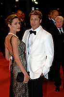 ANGELINA JOLIE &amp; BRAD PITT<br /> Premiere of &quot;The Assassination of Jesse James by the Coward Robert Ford&quot; at the 64th Venice Film Festival (La Biennale di Venezia), Venice, Italy.<br /> September 2nd, 2007<br /> half 3/4 length long black lace layered dress maxi clutch bag pearl necklace couple cream white tuxedo jacket shirt suit black trousers bow tie  mouth open hand in pocket  tattoos<br /> Ref: CAP/PL<br /> &copy;Phil Loftus/Capital Pictures /MediaPunch ***NORTH AND SOUTH AMERICAS ONLY***