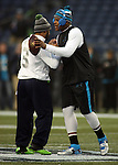 Seattle Seahawks  quarterback Russell Wilson, left, greets Carolina Panthers quarterback Cam Newton, right,  before their game of the NFC Western Division Playoffs at CenturyLink Field in Seattle, Washington on January 10, 2015.The Seahawks beat the Panthers 31-17. ©2015. Jim Bryant Photo. All Rights Reserved.
