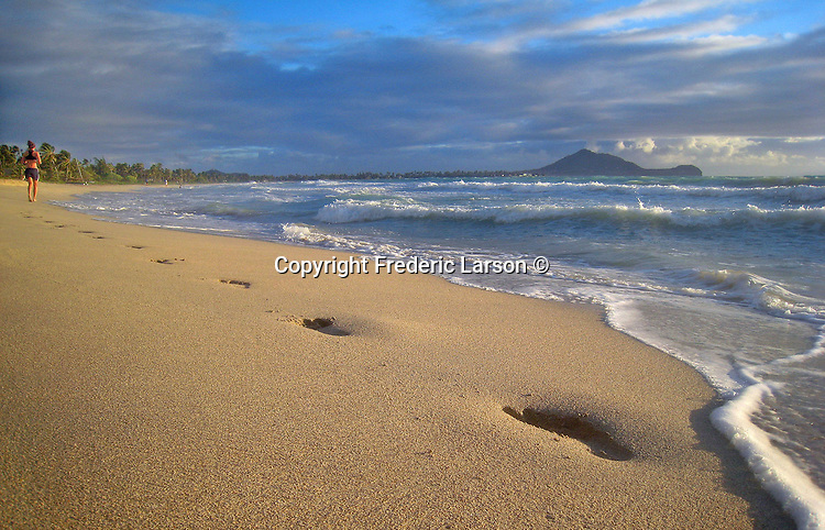 Foot prints along the beach of Kailua Beach in Oahu, Hawaii.
