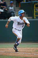 Daniel Amaral (25) of the UCLA Bruins runs to first base during a game against the California Bears at Jackie Robinson Stadium on March 25, 2017 in Los Angeles, California. UCLA defeated California, 9-4. (Larry Goren/Four Seam Images)