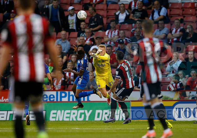 Jake Eastwood of Sheffield Utd punch clear under pressure during the Carabao Cup, second round match at Bramall Lane, Sheffield. Picture date 22nd August 2017. Picture credit should read: Simon Bellis/Sportimage