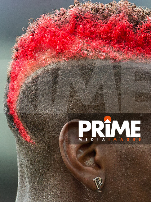 Paul Pogba of Man Utd new hairstyle & personalised ear stud during the Premier League match between Stoke City and Manchester United at the Britannia Stadium, Stoke-on-Trent, England on 9 September 2017. Photo by Andy Rowland.