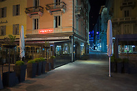 "Switzerland. Canton Ticino. Lugano. Vanini is a famous restaurant cafe place on Piazza Riforma. Saturday Night Life. Nobody in the streets. All restaurants are closed due the the Coronavirus (also called Covid-19). Due to the spread of the coronavirus, the Federal Council has categorised the situation in the country as ""extraordinary"". It has issued a recommendation to all citizens to stay at home, especially the sick and the elderly. The Federal Council (German: Bundesrat, French: Conseil fédéral, Italian: Consiglio federale, Romansh: Cussegl federal) is the seven-member executive council that constitutes the federal government of the Swiss Confederation. From March 16 the government ramped up its response to the widening pandemic, ordering the closure of bars, restaurants, sports facilities and cultural spaces. Only businesses providing essential goods to the population – such as grocery stores, bakeries and pharmacies – are to remain open. 21.03.2020 © 2020 Didier Ruef"