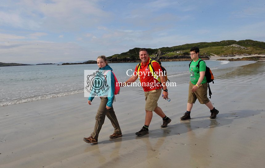 8-7-2017: Will Fitzgerald from Navan, County Meather with his children Megan and Scott pictured walking on Derrynane Strand in County Kerry on Saturday in the Kerry Way Walk in aid of Breakthrough Cancer Research. The three day charity walk around South Kerry attracts walkers from all over Ireland and has raised over &euro;670,000 in its 14 year history.<br /> Photo Don MacMonagle<br /> <br /> Repro free photo breakthrough cancer research
