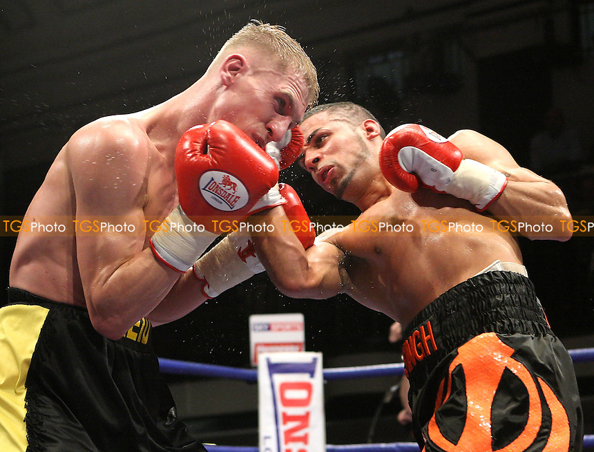Andrew Singh Kooner (Montreal, black/orange shorts) defeats Gavin Reid (Redcar, black/yellow shorts) in a Super-Bantamweight contest at York Hall, promoted by Hennessy Sports - 22/02/08 - MANDATORY CREDIT: Gavin Ellis/TGSPHOTO. Self-Billing applies where appropriate. NO UNPAID USE. Tel: 0845 094 6026