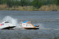 Frame 10: Rob Rinker, (#10), Mark Schmerbach, (#35) and Jeremy Hebert, (#51) race 3-wide into turn 4 where Schmerbach and Hebert make contact with Schmerbach spinning into the path of Rinker who rides up and over the #35 boat and flips upside down.