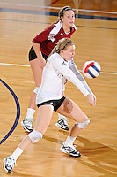 17 November 2011:  Denver defensive specialist/libero Lyndi Johnson (8) returns a serve in the fourth set as the FIU Golden Panthers defeated the Denver University Pioneers, 3-1 (25-21, 23-25, 25-21, 25-18), in the first round of the Sun Belt Conference Tournament at U.S Century Bank Arena in Miami, Florida.