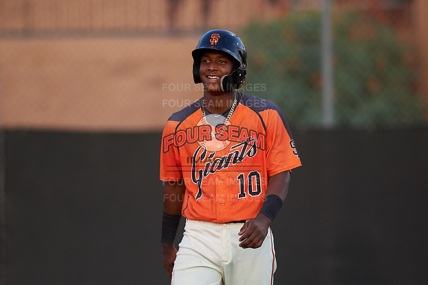 AZL Giants Orange Marco Luciano (10) walks to the dugout after scoring a run during an Arizona League game against the AZL Mariners on July 18, 2019 at the Giants Baseball Complex in Scottsdale, Arizona. The AZL Giants Orange defeated the AZL Mariners 7-4. (Zachary Lucy/Four Seam Images)