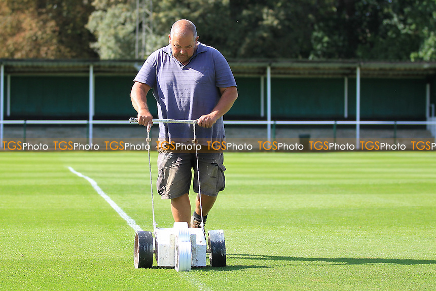 The head groundsman marks out the pitch ahead of Leatherhead vs Needham Market, Ryman League Premier Division Football at Fetcham Grove on 24th September 2016