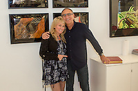 Lisa S. Johnson and Ron Robinson attend the Lisa S. Johnson 108 Rock Star Guitars Artist Reception & Book Signing at Ron Robinson in Santa Monica on Sept. 3, 2015 (Photo by Inae Bloom/Guest of a Guest)