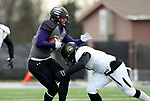 SIOUX FALLS, SD - NOVEMBER 10: Clint Sigg #16 from the University of South Falls is brought down bye Romel Hill #17 from Wayne State during their game Saturday afternoon at Bob Young Field in Sioux Falls. (Photo by Dave Eggen/Inertia)