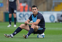 Luke O'Nien of Wycombe Wanderers takes a breather during pre match warm up during the Sky Bet League 2 match between Wycombe Wanderers and Hartlepool United at Adams Park, High Wycombe, England on 5 September 2015. Photo by Andy Rowland.