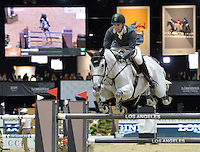 Eduardo Menezes (Brazil), riding Quintol at the Gucci Gold Cup International Jumping competition at the 2015 Longines Masters Los Angeles at the L.A. Convention Centre.<br /> October 3, 2015  Los Angeles, CA<br /> Picture: Paul Smith / Featureflash