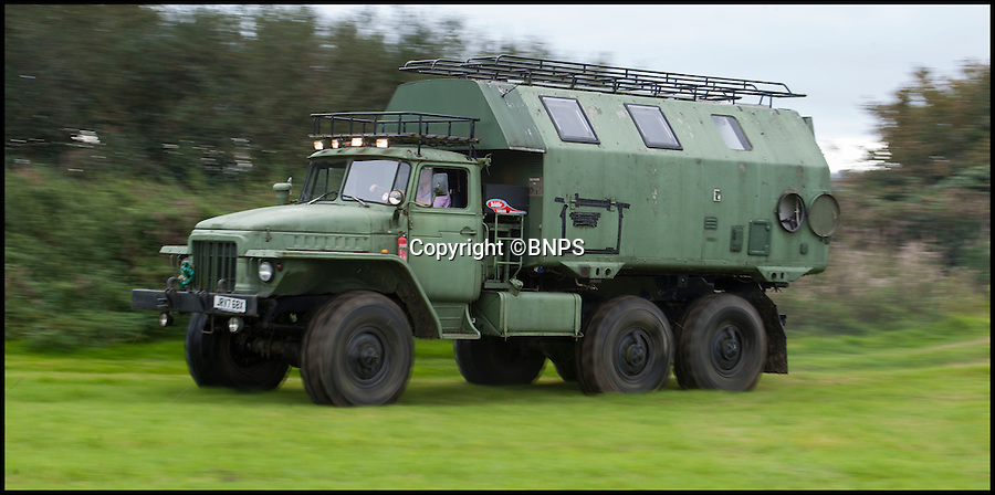 BNPS.co.uk (01202 558833)<br /> Pic: PhilYeomans/BNPS<br /> <br /> Six wheel drive.<br /> <br /> Carry on campski...<br /> <br /> Madcap Chris Armstrong has turned a Cold War Russian army monster truck into the ultimate camper van.<br /> <br /> Chris, 41, has converted the back of the 12.5 ton six wheel drive into luxury accommodation that has a double bed, shower, toilet and its own kitchen with fridge.<br /> <br /> He turns heads whenever he roars onto a countryside campsite in the beast and has actually been banned from several parks because of the sheer size of his communist camper. <br /> <br /> He is now selling it on eBay with a reserve price of £21,000.