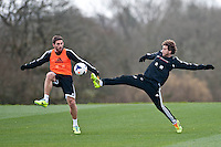 Thursday 20 March 2014<br /> Pictured:( L-R )  Angel Rangel and Jose Canas during training<br /> Re: Swansea City Training at their Fairwood training facility, Swansea, Wales,UK
