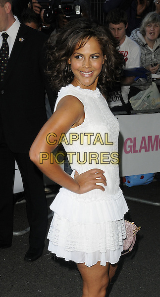 Lenora Crichlow.Glamour Women Of The Year Awards held at Berkeley Square Gardens, London, England..June 7th 2011.half length white sleeveless dress side hand on hip.CAP/CAN.©Can Nguyen/Capital Pictures.