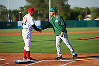 Florida Fire Frogs coach Paul Runge (12) shakes hands with manager Eli Marrero (right) during introductions before a game against the Daytona Tortugas on April 6, 2017 at Osceola County Stadium in Kissimmee, Florida.  Daytona defeated Florida 3-1.  (Mike Janes/Four Seam Images)