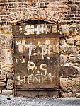 Graffiti on iron door, Historic copper mining city of Butte, Montana