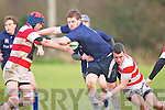 Tralee's Daniel O'Connor tries to push pasted Skibbereen's Colm Hurley and Shane Newman at O'Dowd park, Tralee on Sunday...