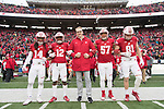 Wisconsin Badgers Honorary Captain Chris McIntosh, center with captains D'Cota Dixon (14), Natrell Jamerson (12), Alec James and Troy Fumagalli (81) prior to an NCAA College Big Ten Conference football game against the Michigan Wolverines Saturday, November 18, 2017, in Madison, Wis. The Badgers won 24-10. (Photo by David Stluka)