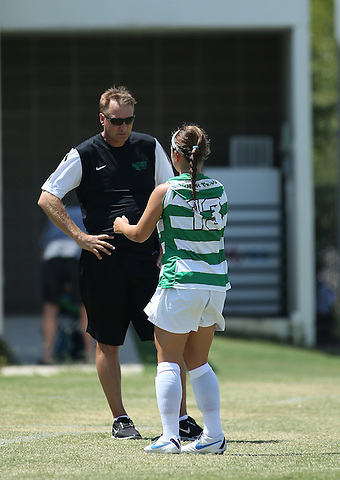 DENTON, TX- AUGUST 25: John Hedlund head coach of the North Texas mean green and Allison Guderian #13 - Houston Baptist vs North Texas Mean Green Soccer at Mean Green Village Soccer Field in Denton on August 25, 2013 in Denton, Texas. Photo by Rick Yeatts