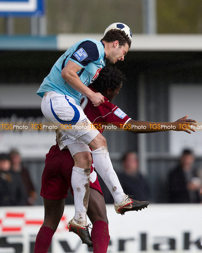 Tom Jordan of Eastleigh beats Cliff Akurang of Chelmsford City in the air - Eastleigh vs Chelmsford City - Blue Square Conference South Football at the Silverlake Stadium - 21/04/12 - MANDATORY CREDIT: Ray Lawrence/TGSPHOTO - Self billing applies where appropriate - 0845 094 6026 - contact@tgsphoto.co.uk - NO UNPAID USE.