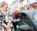 Boyzone's Shane Lynch driving a Matte Balck Porsche arrived into Westport as part of the Canonball 2010, He was welcomed at the finish by Cllr Threasa McGuire and Dermot Langan. Over 160 cars took part in the race that raises funds for Barrettstown .
