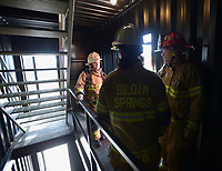NWA Democrat-Gazette/ANDY SHUPE<br /> Mauro Campos (center), battalion chief for the Fayetteville Fire Department, leads a tour Wednesday, March 7, 2018, of the training facility during a training workshop for fire department leadership to meet current National Fire Protection Association standards at the Fayetteville Fire Department training facility in south Fayetteville. Thirty students and instructors from agencies in seven states attended the training meant to train department training officers at current standards.