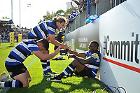 Semesa Rokoduguni of Bath Rugby is congratulated on his second half try with team-mates Max Clark and Freddie Burns. Aviva Premiership match, between Bath Rugby and Saracens on September 9, 2017 at the Recreation Ground in Bath, England. Photo by: Patrick Khachfe / Onside Images