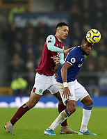 26th December 2019; Goodison Park, Liverpool, Merseyside, England; English Premier League Football, Everton versus Burnley ; Djibril Sidibe of Everton controls the ball under pressure from Dwight McNeil of Burnley - Strictly Editorial Use Only. No use with unauthorized audio, video, data, fixture lists, club/league logos or 'live' services. Online in-match use limited to 120 images, no video emulation. No use in betting, games or single club/league/player publications