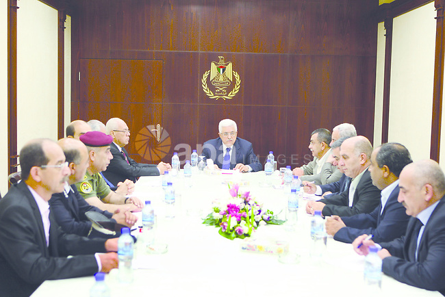 Palestinian President Mahmoud Abbas (Abu Mazen) meets with security chiefs at the presidential headquarters in the West Bank city of Ramallah on Aug 22, 2012. Photo by Thaer Ganaim