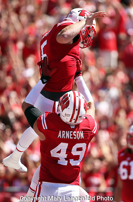 Wisconsin quarterback Tanner McEvoy (5) is lifted by tight end Sam Arneson (49) after McEvoy scored a Wisconsin touchdown against Western Illinois.