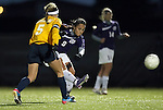 SIOUX FALLS, SD - NOVEMBER 1:  Maria Gonzalez #9 from the University of Sioux Falls passes the ball past Kara Bartels #5 from Augustana in the first half of their game Friday night at the USF Sports Complex. (Photo by Dave Eggen/Inertia)