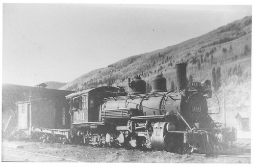 Engineer's-side view of RGS K-27 #461 missing her tender tank at the Rico engine house.<br /> RGS  Rico, CO  Taken by Perry, Otto C. - 10/6/1950